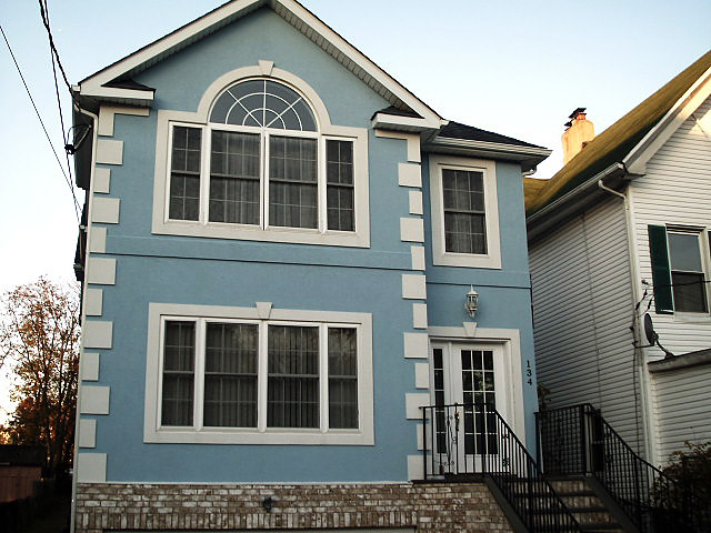Stucco rockland westchester bronx harrison ny for Blue house builders